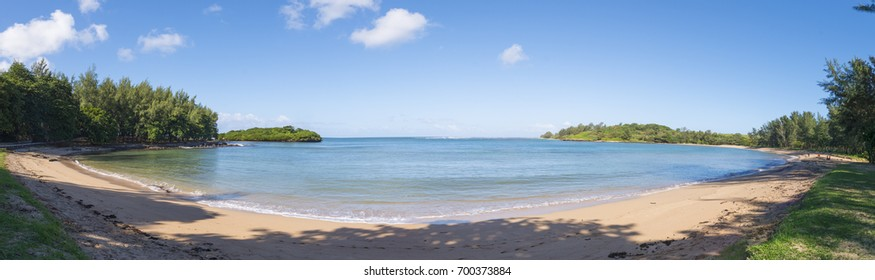 A panoramic view of a small round sea bay on a sunny day in Mauritius