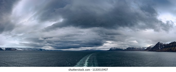 Panoramic view of snow capped mountain and the harbor in  Isafjordur city from cruise ship in Westfjords, Northern Iceland