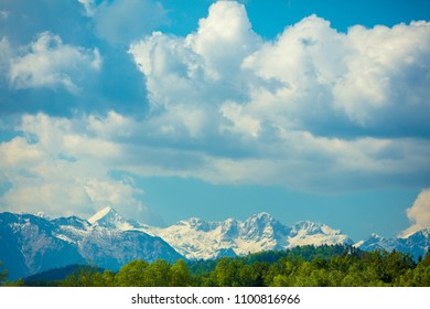 Panoramic view of snow mountain range landscape with blue cloudy sky. Beautiful nature Italy