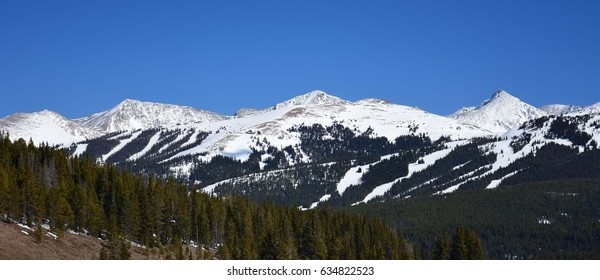 panoramic view of snow-capped mountains and copper mountain ski area from  the top of vail pass, in colorado