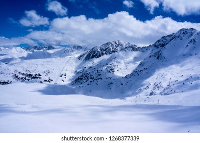 Panoramic view of snowy mountain peaks and ski runs, in the Pyrenees and Alp mountains, Andorra, France, Europe