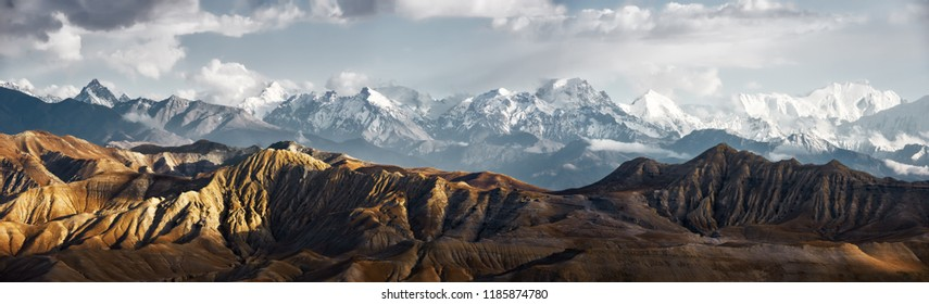 Panoramic view of the snowy mountains in Upper Mustang, Annapurna Nature Reserve, trekking route, Nepal - Shutterstock ID 1185874780