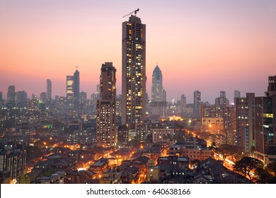 Panoramic view of south central Mumbai - the financial capital of India - at golden hour with dwellings of lower middle class in foreground and towers where elite stay in the far background.