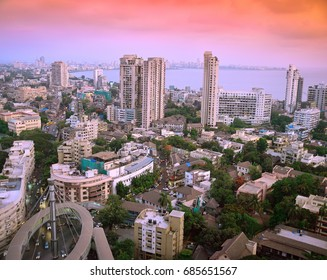 Panoramic view of South Mumbai (India) skyline at golden hour with ultra modern aesthetically designed skywalks, high rises slowly but surely giving way to old, traditional cottages, bungalows etc.