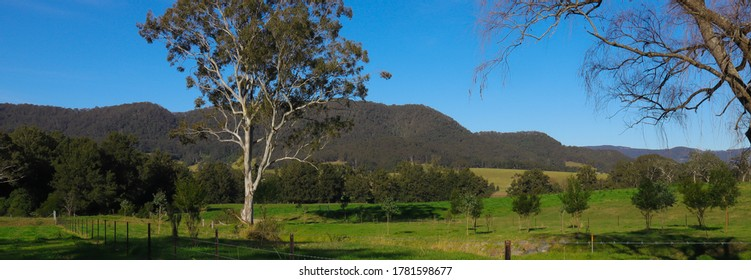 Panoramic view of the southern highlands Kangaroo Valley lush green pastures blue skies