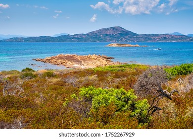 Panoramic view of Spalmatore di Terra peninsula of Marine Protected Area natural reserve with seashore rocks of Isola Tavolara island on Tyrrhenian Sea off northern coast of Sardinia, Italy