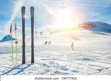 Panoramic view of sport resort for winter vacation - Skies with back light - Warm filter with original sun color tones