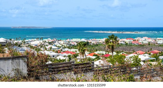 A panoramic view of St Maarten with coloful homes in the Caribbean Sea.