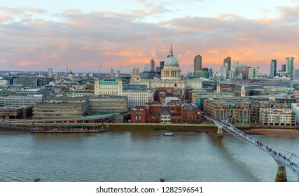 Panoramic view of St. Paul Cathedral and Millennium Bridge at sunset, London, UK