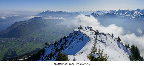 Panoramic view from Stanserhorn in Central Switzerland, with the snowy Stanserhorn mountain ridge. Northern Lake Lucerne and Mt Rigi can be seen in the distance.