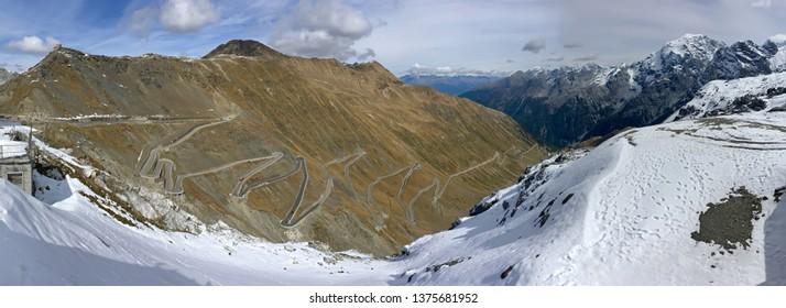 Panoramic view of Stelvio Pass, hairpin turns of mountain pass named Stilfser Joch in Deutsch, in Italy during Autumn