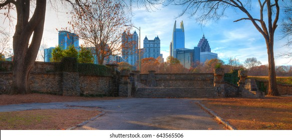 Panoramic view of stone stairs in the Piedmont Park and Midtown Atlanta behind it in autumn day, USA