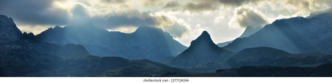Panoramic view of summer mountain range and belt system with beautiful mountain peak. Durmitor, Montenegro