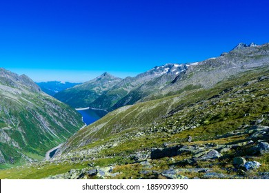 Panoramic view with sunrise on idyllic mountain backdrop in the Alps with fresh green meadows in summer Stange near Zillergrundl. Austria Zillertaler Alpen tirol