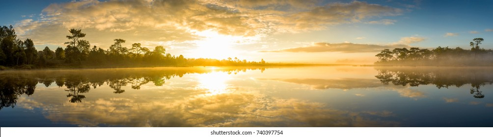 Panoramic view of sunrise over the lake in nation park, Beautiful rainforest landscape with fog in morning, Thailand