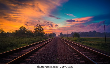 Panoramic view of the sunset and 2 the railway in the middle of the photo