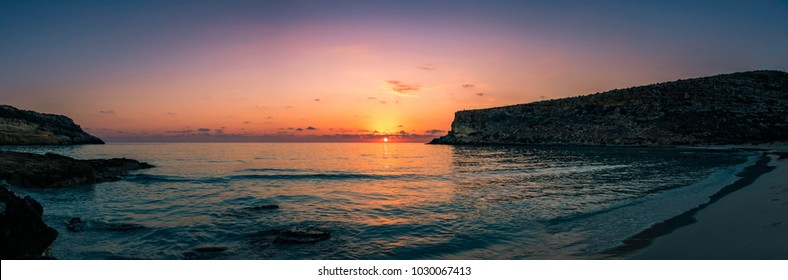 Panoramic view of a sunset over the Rabbit beach in Lampedusa, Sicily. The beach is protected because the extinct loggerhead turtles lay their eggs in the area.