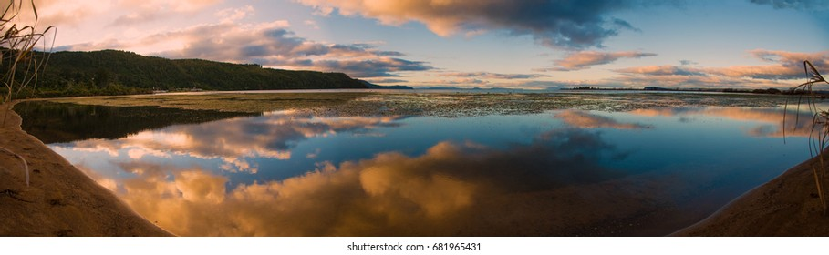 Panoramic View of the Sunset Reflection at Lake Taupo