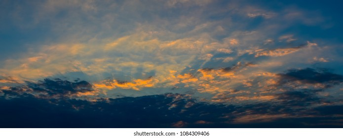 Panoramic view of sunset sky with blue sky and clouds