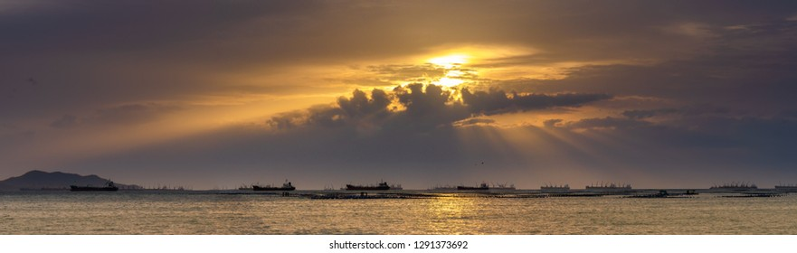 Panoramic view of sunset sky at  Sriracha city with Si Chang island background in Chonburi, Thailand