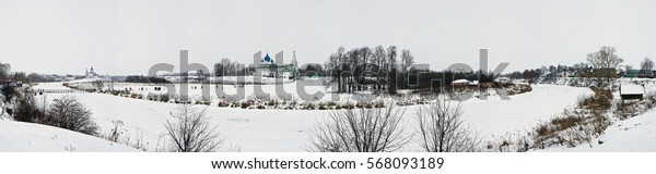 The panoramic view of Suzdal in winter on the Kamenka river, Cathedral of the Nativity of the Theotokos and the Kremlin in Russia