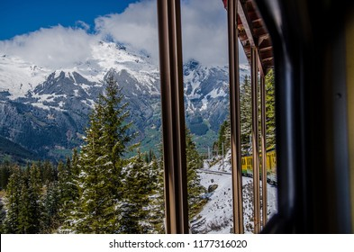 panoramic view of swiss mountain outside windows