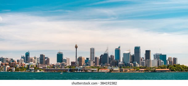 Panoramic view at Sydney city urban skyline from Western Plains with blue sky and clouds on a bright day