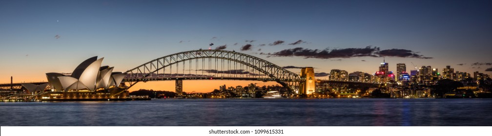 Panoramic view of Sydney harbour and skyline at dusk, Sydney NSW, Australia