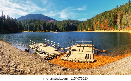 Panoramic view of Synevir high altitude lake at autumn day the leaf fall.