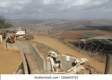 Panoramic view of Syria at winter and concrete trench and pillbox on Mount Bental Israeli military outpost on the border - disused bunker in the Golan Heights
