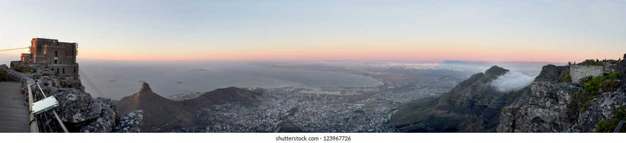 A panoramic view from Table Mountain, over the Cape Town City Bowl area, towards Robben Island, in Table Bay, also showing the Cable Car station. It is a New 7th Wonder of the World.