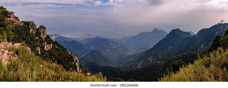 """Panoramic view from Tai Shan (""""Mount Tai""""), one of the Chinese """"Five Great Mountains"""" of Daoism. In the dust of the valley lies the city of Tai'an - Panorama from 7 pictures"""