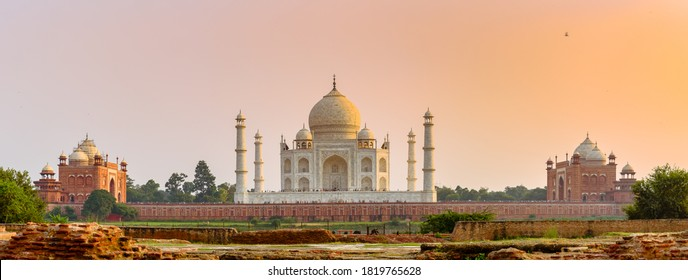 Panoramic View of The Taj Mahal complex across the Yamuna River at the time of sunset - Agra, India.