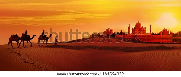 Panoramablick auf Taj Mahal bei Sonnenuntergang. Kamelkarawane durch die Wüste. Indien