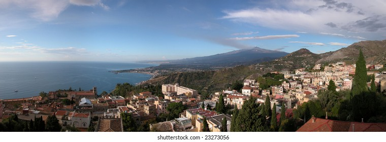 Panoramic view of Taormina with Etna volcano in the background. Picture stitched from multiple photos.