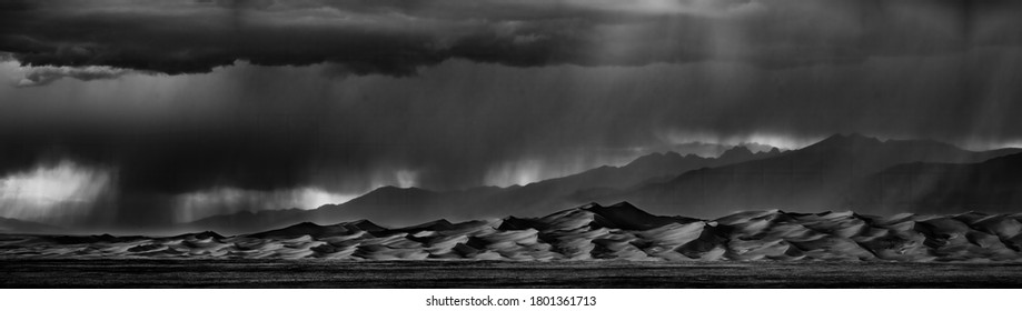Panoramic view of thunderstorms over sand dunes in Colorado