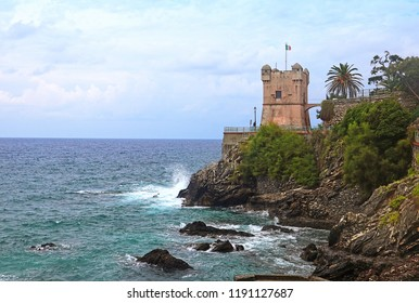 Panoramic view of the Tigullio gulf from the sea promenade  on the rocky coast of Genoa Nervi with the medieval Gropallo tower  built in the 16th-century as a watchtower for pirates.