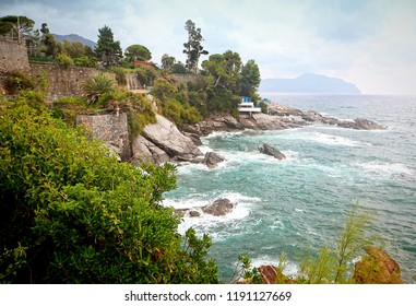 Panoramic view of the Tigullio gulf  with stormy weather from the sea promenade on the rocky coast of Genoa Nervi, Liguria, Italy