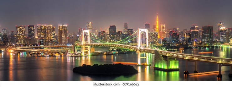 Panoramic view of Tokyo Tower and Rainbow Bridge in Tokyo, Japan. Rainbow Bridge is a suspension bridge crossing Tokyo Bay between Shibaura and Odaiba waterfront development in Minato, Tokyo, Japan.