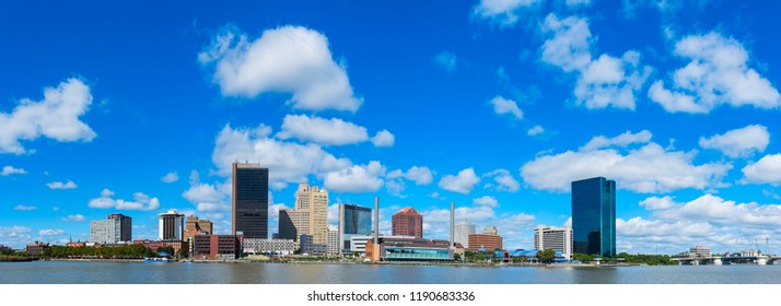 Panoramic view of Toledo downtown skyline with blue sky and white clouds, Ohio