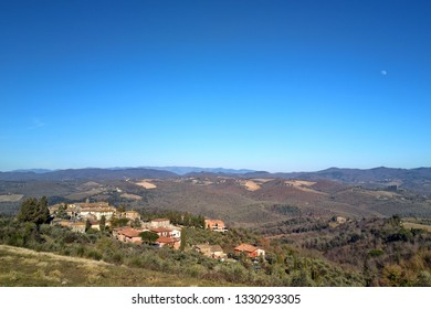 Panoramic View from top of the hill on the town of Vagliagli, Chianti, Tuscany, Italy. Daylight, Green grass, Woods, Forests, Big blue sky, Vineyards. Fall winter, Spring.