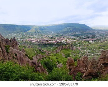 Panoramic view from top of hills surrounding town on Goris, Armenia, and on geological park, so called Stone Forest. Zangezur mountains are on background. Goris is most rainy city in Armenia