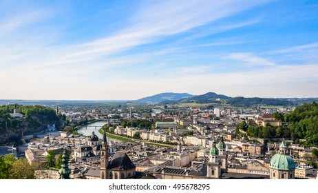 Panoramic view from the top of Hohensalzburg fortress (Castle) to the historic city center of Salzburg with Salzach river and Alps on background, Salzburger Land, Austria - architecture background