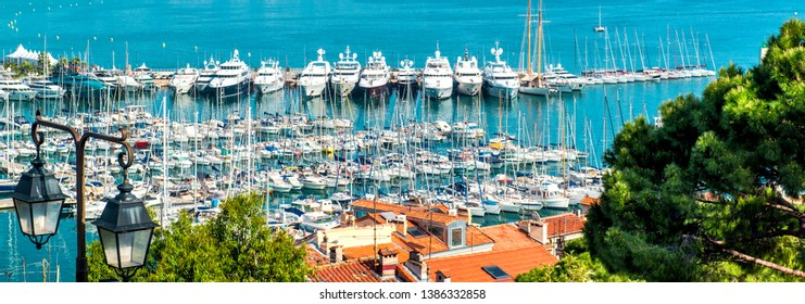 Panoramic view from the top moored nautical vessels motorboats yachts moored in the Port Le Vieux and La Croisette of Cannes, France