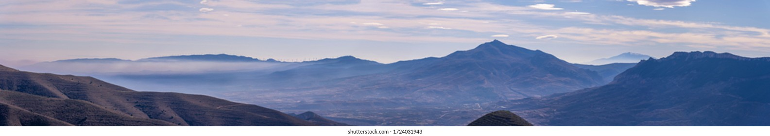 panoramic view from the top of a whole valley, mountains, fog, rivers, etc