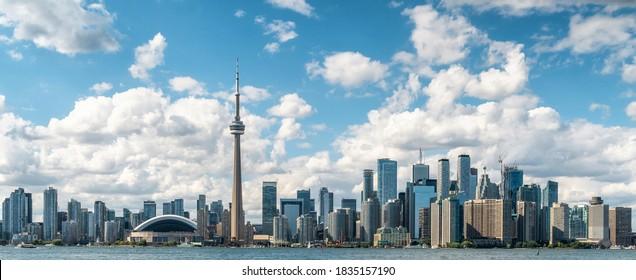 Panoramic view of Toronto skyline and Lake Ontario on a sunny day, Toronto, Ontario, Canada.