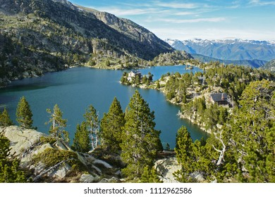 Panoramic view of the Tort de Peguera lake with the J. M. Blanc refuge in the middle, Aiguestortes, Pyrenees, Lleida, Catalonia
