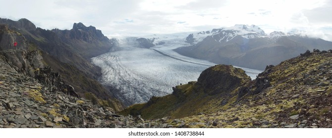 Panoramic view with tourist admiring glacier in National Park Skaftafell in South Iceland