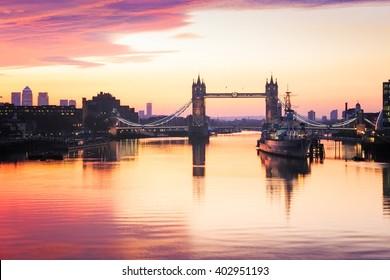 Panoramic view of Tower Bridge in London at sunrise.