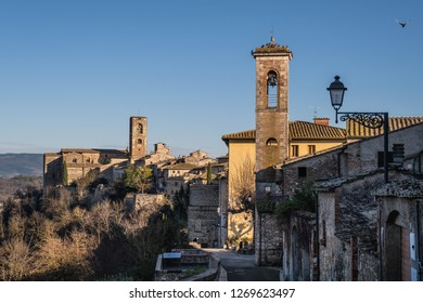 Panoramic view with the towers of the church of Santa Caterina and the Praetorian Palace of the medieval village of Colle di Val d'Elsa, Siena, Tuscany
